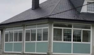 Cierre de balcón con ventanas de corredera